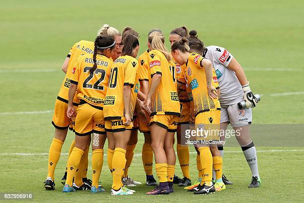 Glory players form a huddle during the round 14 WLeague match between the Western Sydney Wanderers and Perth Glory at Popondetta Park on January 29...