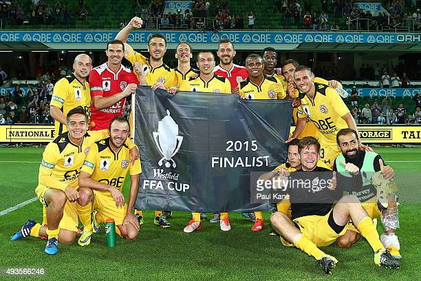 Glory players pose with the '2015 Finalist flag' after winning the FFA Cup Semi Final match between Perth Glory and Melbourne City FC at nib Stadium...