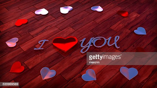 glossy heart shapes on wood floor with sign I love : Stock Photo