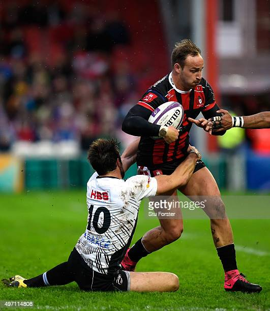 Gloucester centre Bill Meakes breaks the tackle of Zebra fly half Edoardo Padovani during the European Rugby Challenge Cup match between Gloucester...