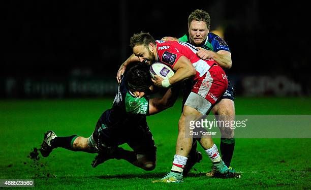 Gloucester centre Bill Meakes is tackled by Eoghan Masterson and Tom McCartney during the European Rugby Challenge Cup Quarter Final match between...