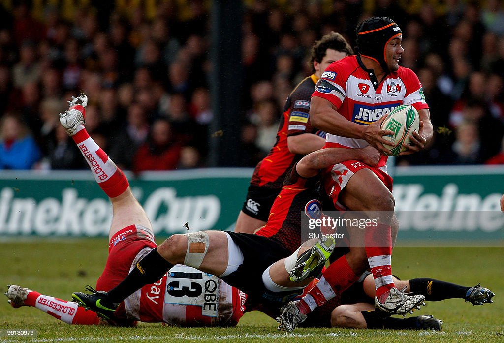 Gloucester centre Eliota FuimaonoSapolu breaks a tackle to set up the first Gloucester try during the Heineken Cup Pool 2 Round 6 match between...