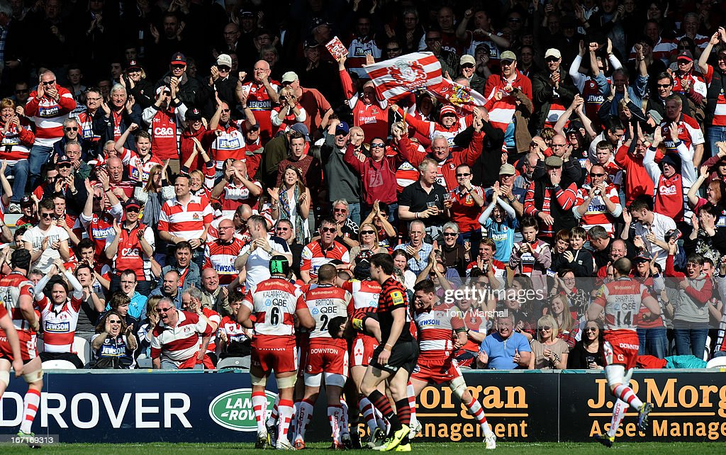 Gloucester fans celebrate as Ben Morgan scores a try in front of them during the Aviva Premiership match between Gloucester and Saracens at Kingsholm Stadium on April 20, 2013 in Gloucester, England.
