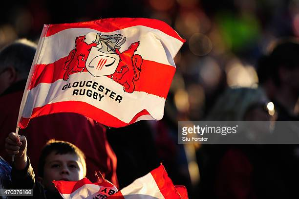 Gloucester fans wave their flags during the European Rugby Challenge Cup semi final match between Gloucester Rugby and Exeter Chiefs at Kingsholm...