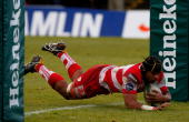 Gloucester forward Akapusi Qera dives over to score the first Gloucester try during the Heineken Cup Pool 2 Round 6 match between Newport Gwent...