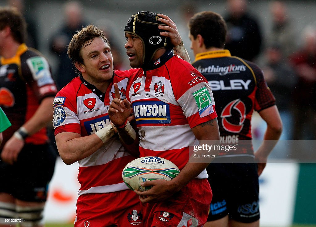 Gloucester forward Akapusi Qera is congratulated by Rory Lawson after scoring the first Gloucester try during the Heineken Cup Pool 2 Round 6 match...