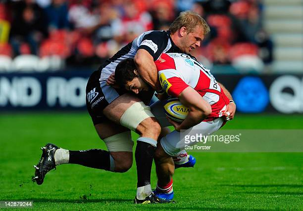 Gloucester fullback Jonny May runs into the tackle of Falcons player Adam Balding during the Aviva Premiership match between Gloucester and Newcastle...