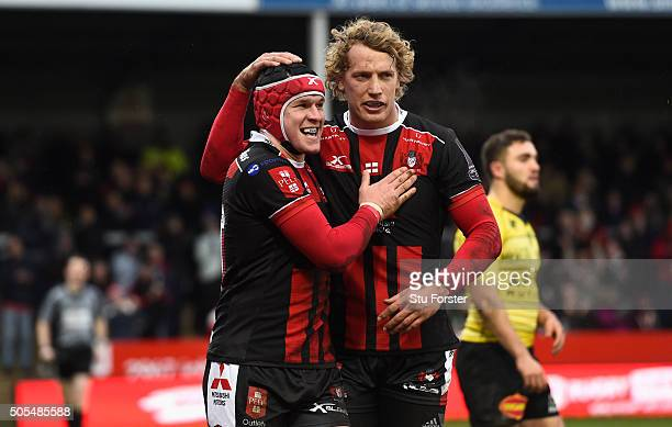 Gloucester fullback Rob Cook celebrates with Billy Twelvetrees after scoring the first try during the European Rugby Challenge Cup match between...