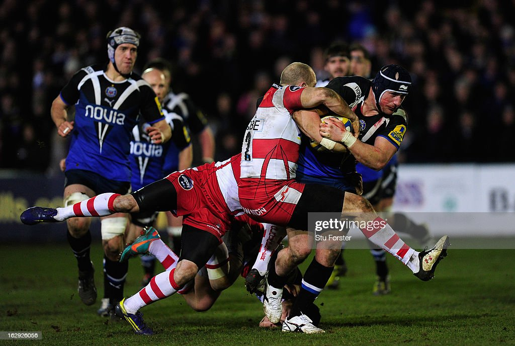 Gloucester hooker Darren Dawidiuk (l)attempts to tackle Bath forward Dave Atwood during the Aviva Premiership match between Bath and Gloucester at Recreation Ground on March 1, 2013 in Bath, England.