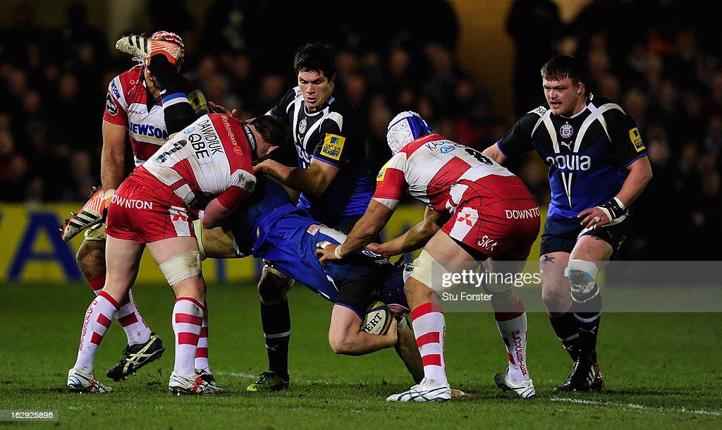 Gloucester hooker Darren Dawidiuk (l) tackles Dave Atwood and is subsequently red carded during the Aviva Premiership match between Bath and Gloucester at Recreation Ground on March 1, 2013 in Bath, England.