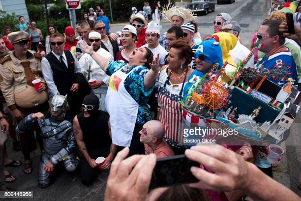 Gloucester Mayor Sefatia Romeo Theken leads a chant with her constituents during the St Peter's Fiesta in Gloucester MA on Jun 25 2017 Each year a...