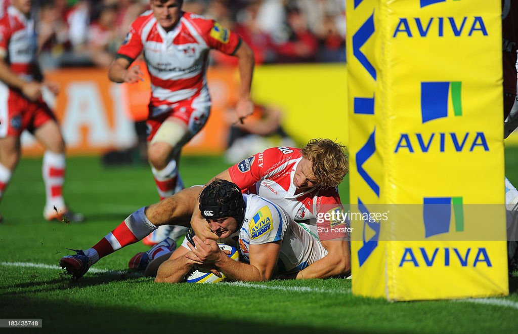 Gloucester player <a gi-track='captionPersonalityLinkClicked' href=/galleries/search?phrase=Billy+Twelvetrees&family=editorial&specificpeople=6175351 ng-click='$event.stopPropagation()'>Billy Twelvetrees</a> (r) fails to stop <a gi-track='captionPersonalityLinkClicked' href=/galleries/search?phrase=Dean+Mumm&family=editorial&specificpeople=612132 ng-click='$event.stopPropagation()'>Dean Mumm</a> of Exeter from crossing to score during the Aviva Premiership match between Gloucester and Exeter Chiefs at Kingsholm Stadium on October 6, 2013 in Gloucester, England.