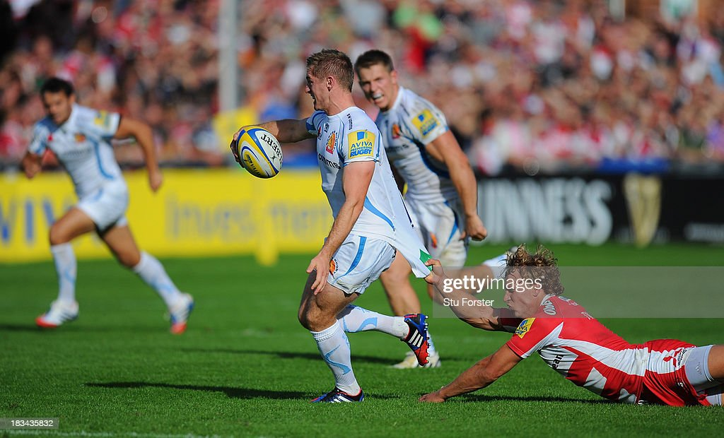 Gloucester player <a gi-track='captionPersonalityLinkClicked' href=/galleries/search?phrase=Billy+Twelvetrees&family=editorial&specificpeople=6175351 ng-click='$event.stopPropagation()'>Billy Twelvetrees</a> (r) fails to stop Gareth Steenson of Exeter from breaking away during the Aviva Premiership match between Gloucester and Exeter Chiefs at Kingsholm Stadium on October 6, 2013 in Gloucester, England.