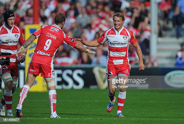 Gloucester player Jimmy Cowan congratulates Billy Twelvetrees after he had scored a try during the Aviva Premiership match between Gloucester and...