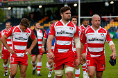 Gloucester players show their dejection as they leave the field after the European Champions Cup PlayOff match between Gloucester Rugby and...