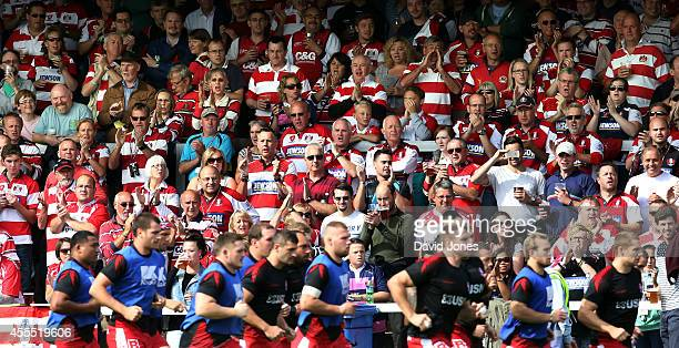 Gloucester Rugby supporters in 'the Shed' cheer their team before the Aviva Premiership match between Gloucester Rugby and Sales Sharks at Kingsholm...