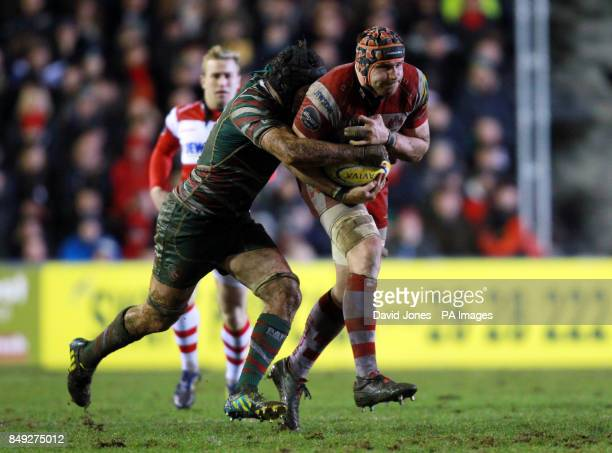 Gloucester Rugby's Ben Morgan is tackled by Leicester Tigers Julian Salvi during the Aviva Premiership match at Welford Road Leicester