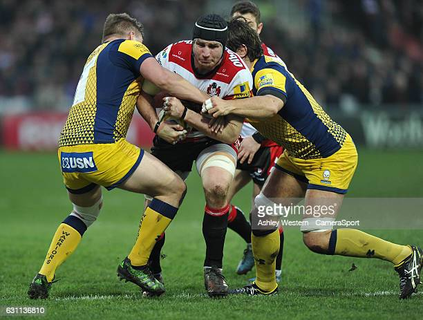 Gloucester Rugby's Ben Morgan is tackled by Worcester Warriors' Jack Singleton and Donncha O'Callaghan during the Aviva Premiership match between...