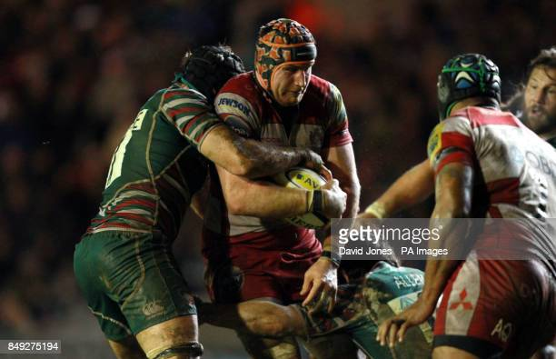 Gloucester Rugby's Ben Morgan is tackled Leicester Rugby's Julian Salvi and Anthony Allen during the Aviva Premiership match at Welford Road Leicester