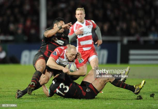 Gloucester Rugby's Mike Tindall is tackled by Edinburgh Rugby's Ben Atiga and Joaquin Dominguez during the Heineken Cup Pool Six match at Kingsholm...