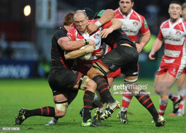 Gloucester Rugby's Mike Tindall is tackled by Edinburgh Rugby's Roddy Grant and Izak van der Westhuizen during the Heineken Cup Pool Six match at...