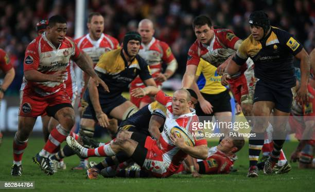 Gloucester Rugby's Mike Tindall is tackled by Worcester Warriors' defence during the Aviva Premiership match at the Kingsholm Stadium Gloucester