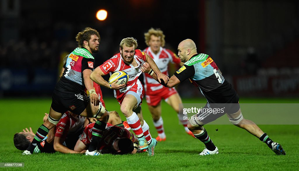 Gloucester scrum half Dan Robson is tackled by <a gi-track='captionPersonalityLinkClicked' href=/galleries/search?phrase=George+Robson+-+Rugby+Player&family=editorial&specificpeople=11374681 ng-click='$event.stopPropagation()'>George Robson</a> as he makes a break during the Aviva Premiership match between Gloucester Rugby and Harlequins at Kingsholm Stadium on November 14, 2014 in Gloucester, England.