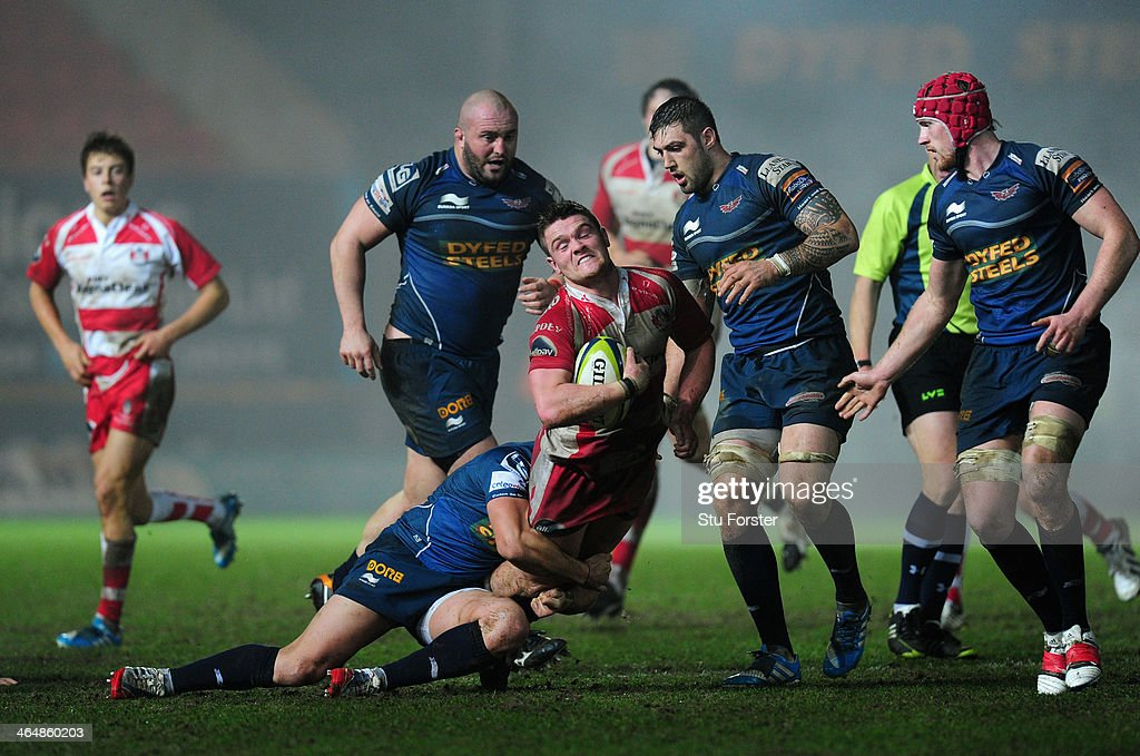 Gloucester scrum half Tavis Knoyle runs into the Scarlets defence during the LV= Cup match between Scarlets and Gloucester Rugby at Parc y Scarlets...