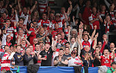 Gloucester supporters celebrate during the Gloucester Rugby v Connacht Rugby European Champions Cup PlayOff at Kingsholm Stadium on May 24 2015 in...