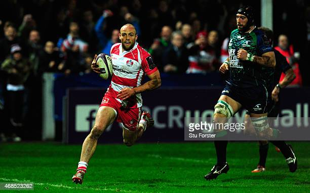 Gloucester wing Charlie Sharples runs in the first try during the European Rugby Challenge Cup Quarter Final match between Gloucester Rugby and...