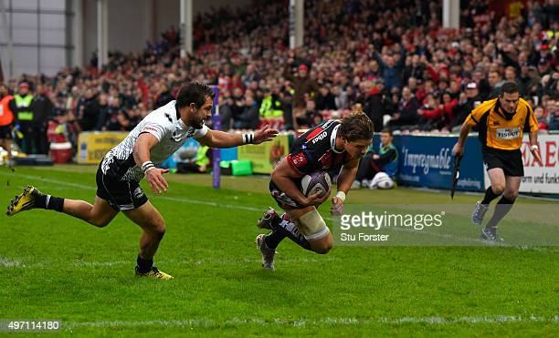 Gloucester wing Henry Purdy crosses for the first try as Zebra fullback Guglielmo Palazzani looks on during the European Rugby Challenge Cup match...