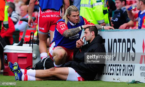 Gloucester wing Jonny May is consoled by replacement Richard Hibbard after leaving the pitch injured during the first half during the Aviva...