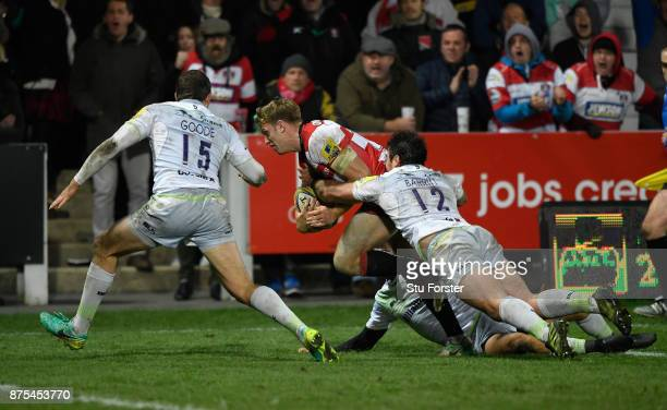 Gloucester wing Ollie Thorley goes over to score the first Gloucester try during the Aviva Premiership match between Gloucester Rugby and Saracens at...