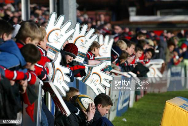 Gloucester's fans with rubber hands enjoy the game against Saracens