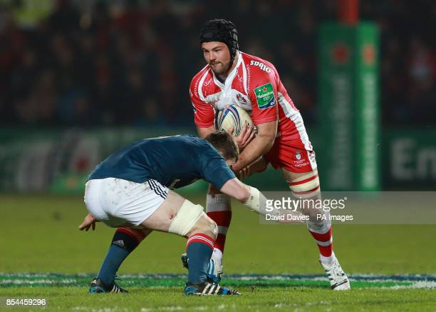 Gloucester's Gareth Evans is tackled by Munster's Peter O'Mahony during the Heineken Cup Pool Six match at Kingsholm Stadium Gloucester