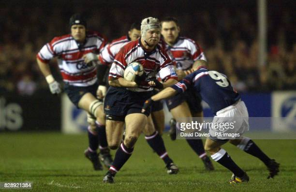 Gloucester's Jake Boer charges into the tackle of Munster's Peter Stringer during today's Heineken Cup Pool Five match at Kingsholm Gloucester...