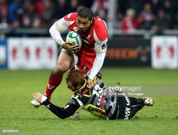 Gloucester's Lesley Vainikolo runs through the tackle of Calvisano's Gonzalo Garcia during the Heineken Cup match at Kingsholm Gloucester