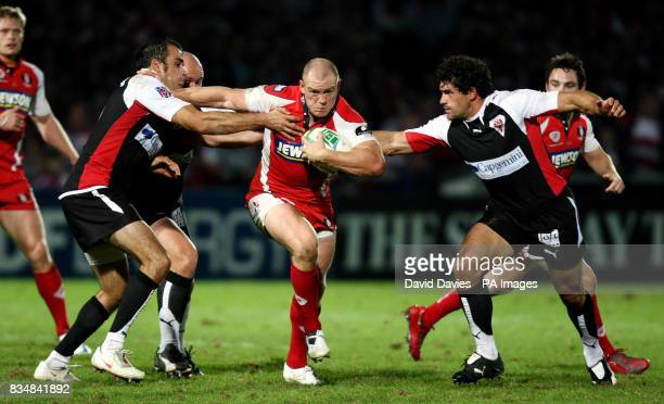 Gloucester's Mike Tindall breaks through a gap in the Biarritz defence during the Heineken Cup match at Kingsholm Stadium Gloucester