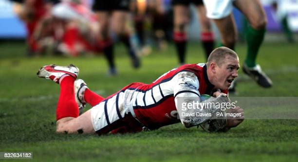Gloucester's Mike Tindall dives over to score the first try against Edinburgh during the Heineken Cup match at Kingsholm Gloucester