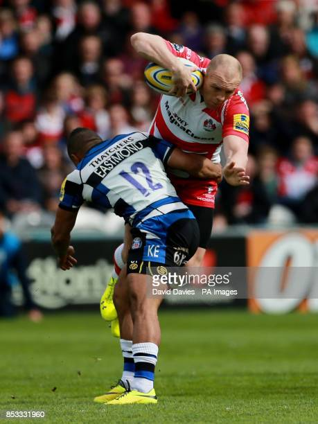 Gloucester's Mike Tindall is tackled by Bath's Kyle Eastmond during the Aviva Premiership match at Kingsholm Stadium Gloucester
