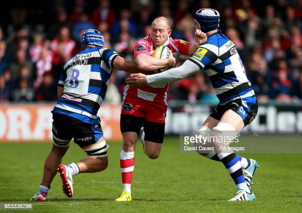Gloucester's Mike Tindall is tackled by Bath's Leroy Houston and Dave Attwood during the Aviva Premiership match at Kingsholm Stadium Gloucester