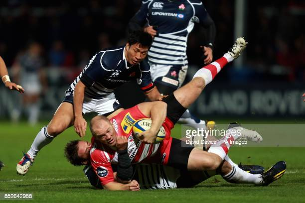 Gloucester's Mike Tindall is tackled by Japan's Justin Ives during an International Friendly at Kingsholm Stadium Gloucester