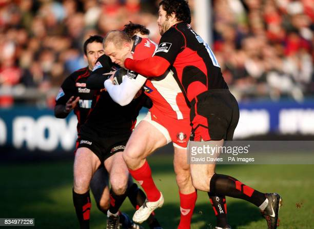 Gloucester's Mike Tindall is tackled by Saracens' Andy Farrell during the Guinness Premiership match at the Kingsholm Stadium Gloucester