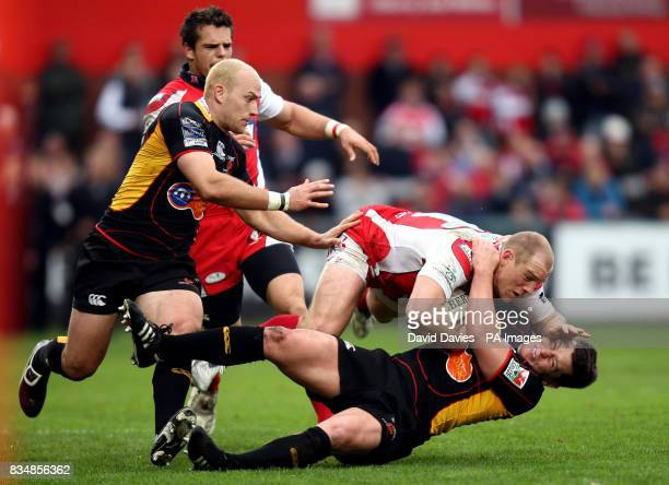 Gloucester's Mike Tindall is tackled to the ground by Newport Gwent Dragons' Rhodri Gomer Davies during the EDF Energy Cup match at Kingsholm Stadium...