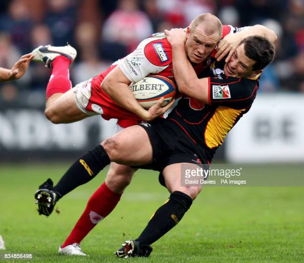 Gloucester's Mike Tindall is tackled to the ground by Newport Gwent Dragons Rhodri Gomer Davies during the EDF Energy Cup match at Kingsholm Stadium...