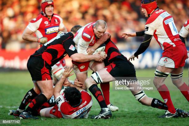 Gloucester's Mike Tindall tries to battle through Saracens defence during the Guinness Premiership match at the Kingsholm Stadium Gloucester
