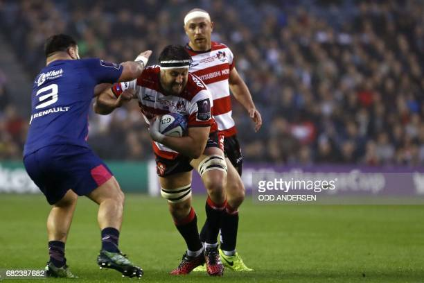 Gloucester's New Zealand lock Jeremy Thrush is tackled by Stade Francais' French prop Rabah Slimani during the rugby union European Challenge Cup...