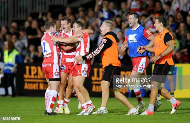 Gloucester's players and coaching staff celebrate after the final whistle during the JP Morgan Prem Rugby 7's at the Recreation Ground Bath
