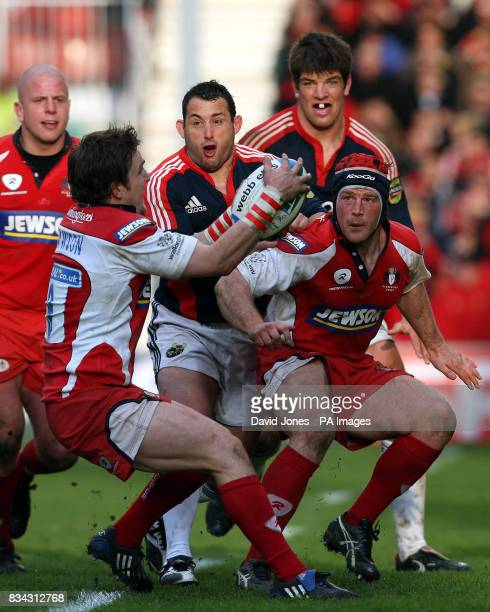 Gloucester's Rory Lawson gathers the ball under presure from Munster's Federico Pucciariello during the Heineken Cup Quarter Final match at Kingsholm...