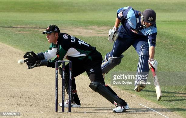 Gloucestershire batsman Alex Gidman just makes his ground before Worcestershire wicketkeeper Steve Davies can remove the bails during the NatWest...